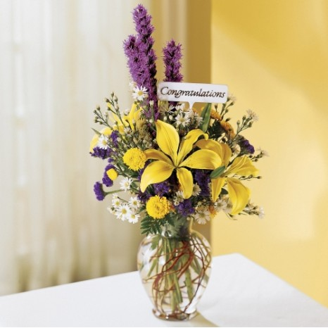 Yellow lilies, purple liatris and yellow pompons vase
