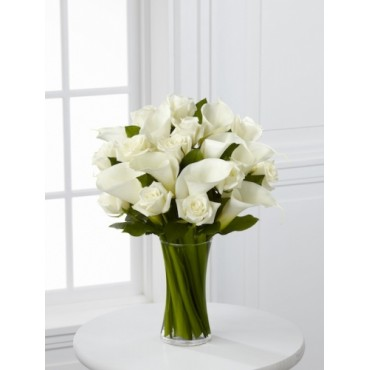 White roses and calla lilies vase