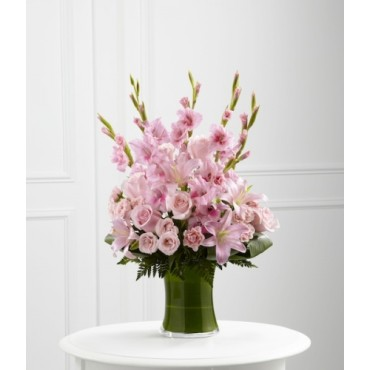 Arrangement of gladiolus, roses and lilies